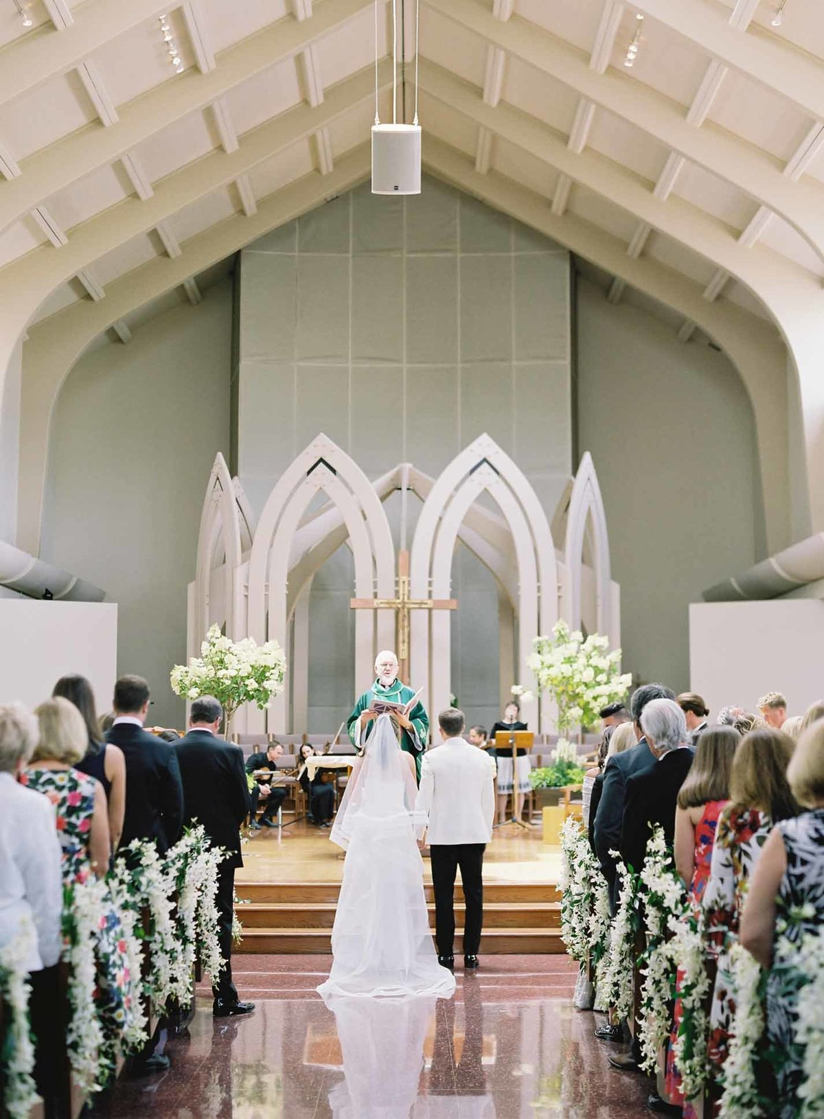 How elegant Sacred Heart Church in Medina looked for this white summer wedding ceremony.