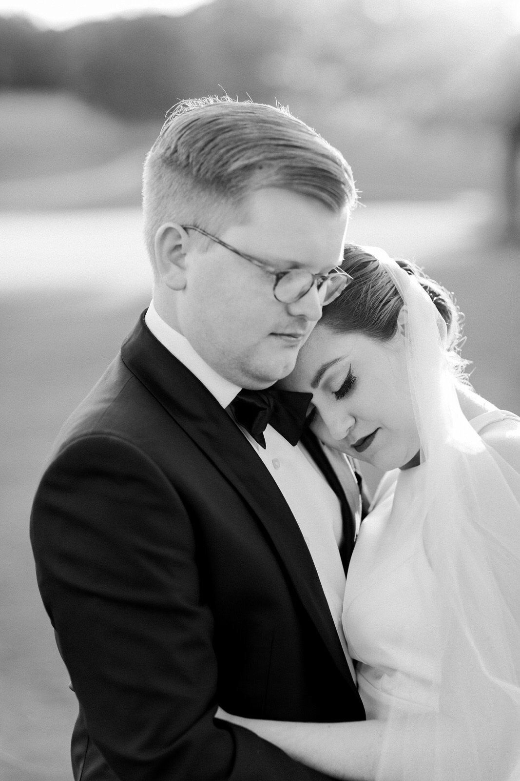 Fine art North Carolina wedding photographer captures a couple during their wedding day portraits during their modern Forsyth Country Club wedding.