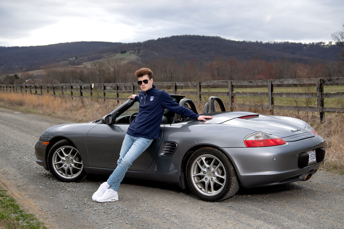 senior boy with convertible car on country roads