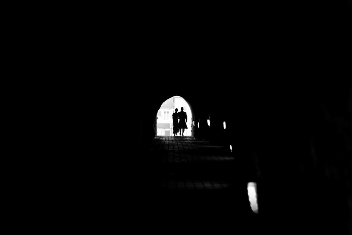 Couple in the Tunnels at Tunnels Beaches Devon