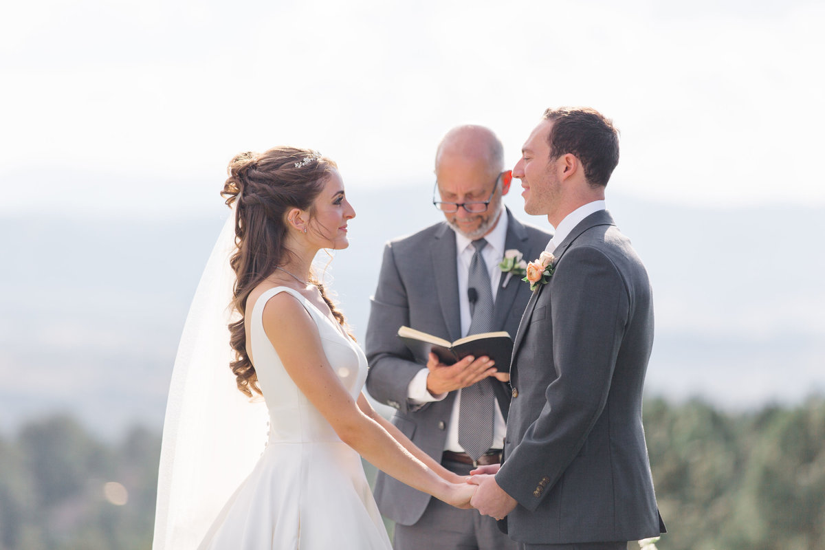 Bride and groom exchanging vows at Castle Pines Golf Club