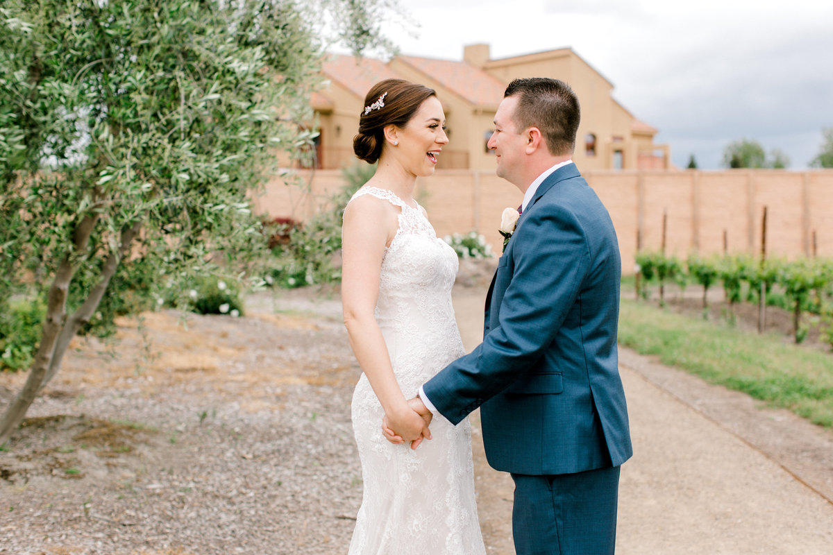 Bride and groom smiling at eachother during first look at Vintners Inn in Santa Rosa California