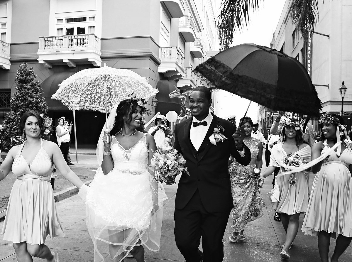 bride smiling at groom during wedding second line parade