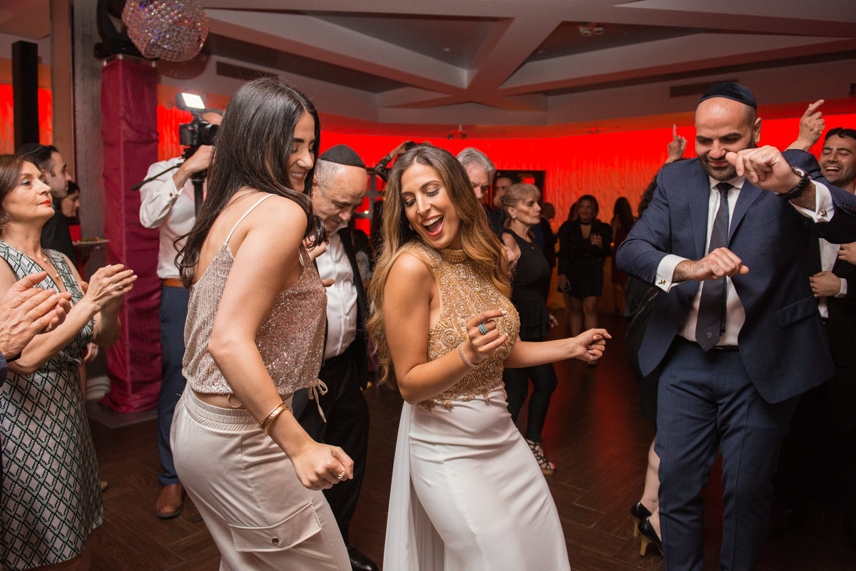 bride dancing with guests at wedding reception at Sephardic Temple