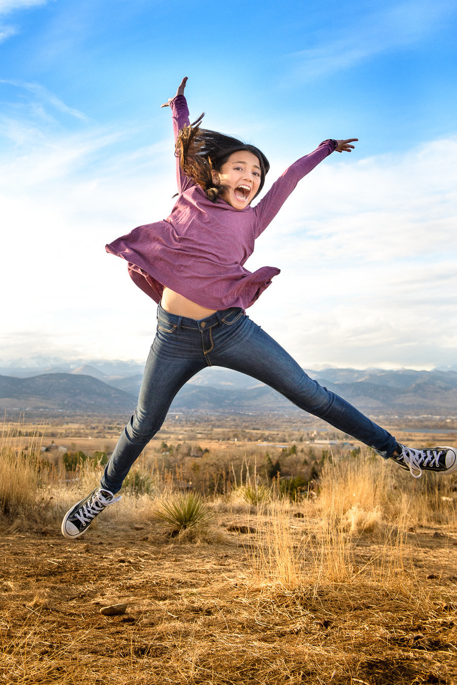 Girl jumping at Davidson Mesa