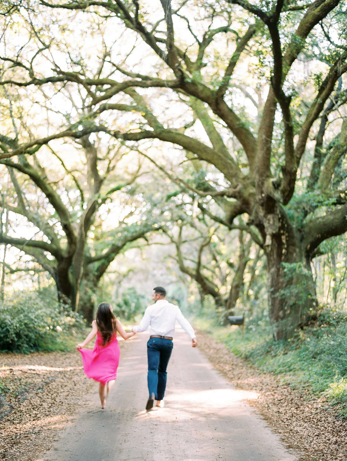 Fun engagement pictures under oak trees.