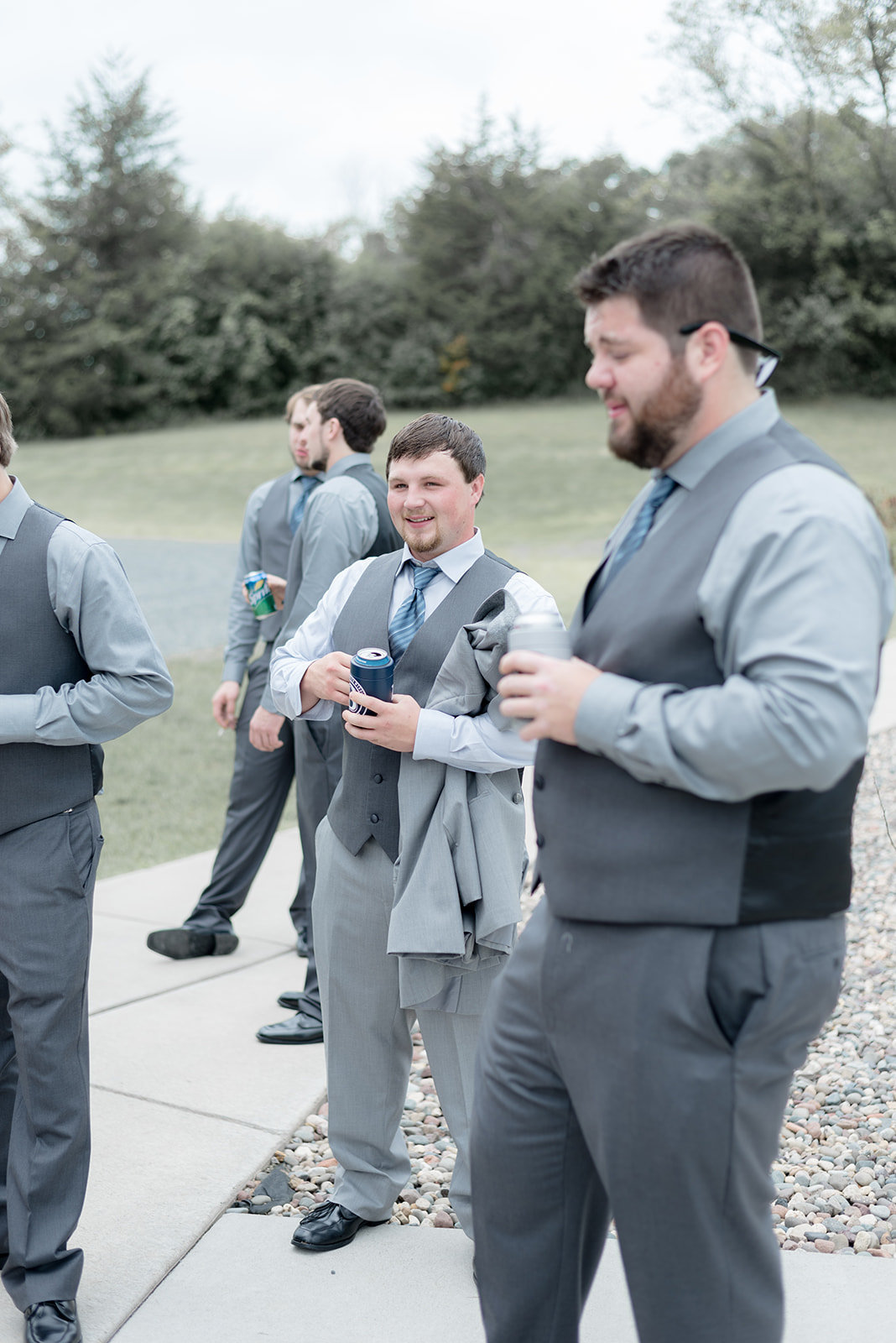 Groom hanging out with his groomsmen at Ridgetop in Prescott Wisconsin