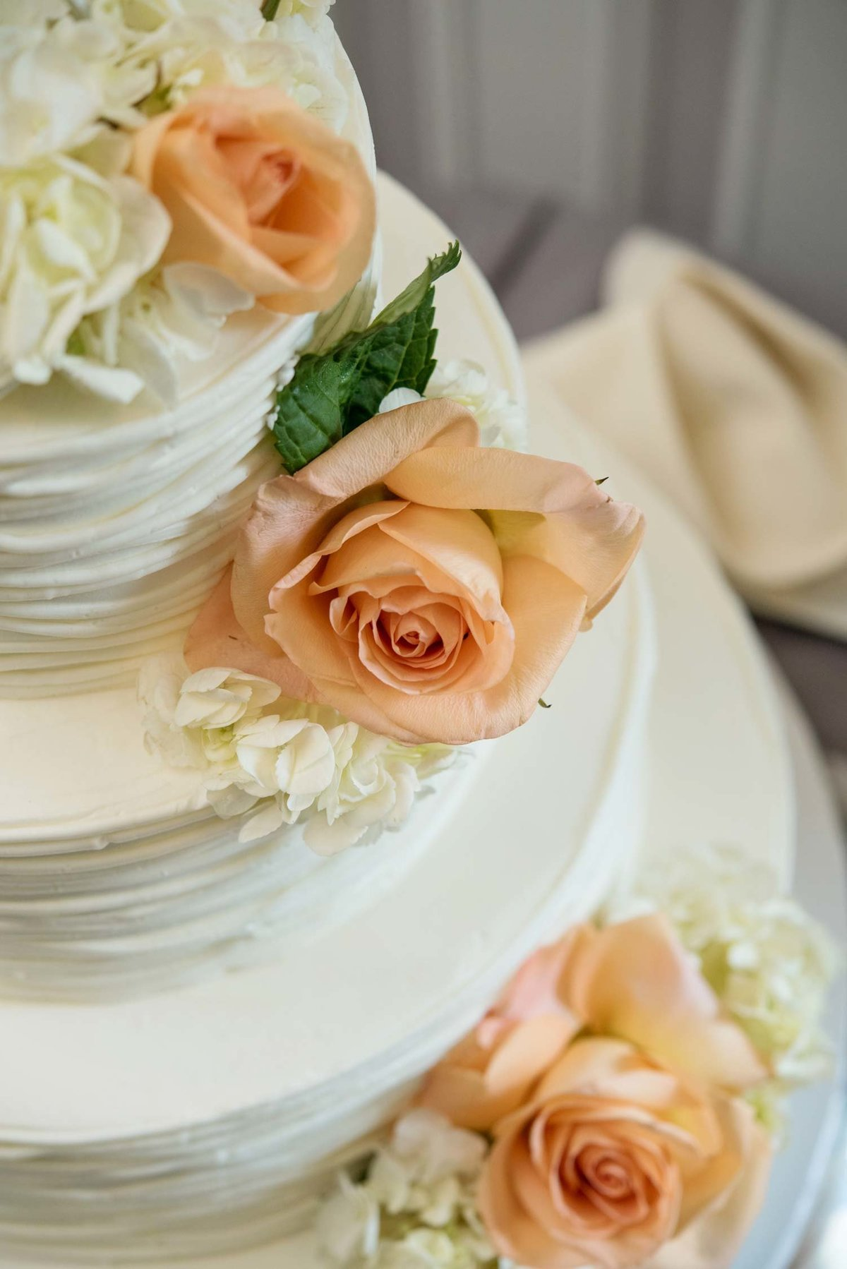 Close up of white wedding cake with flowers at Flowerfield