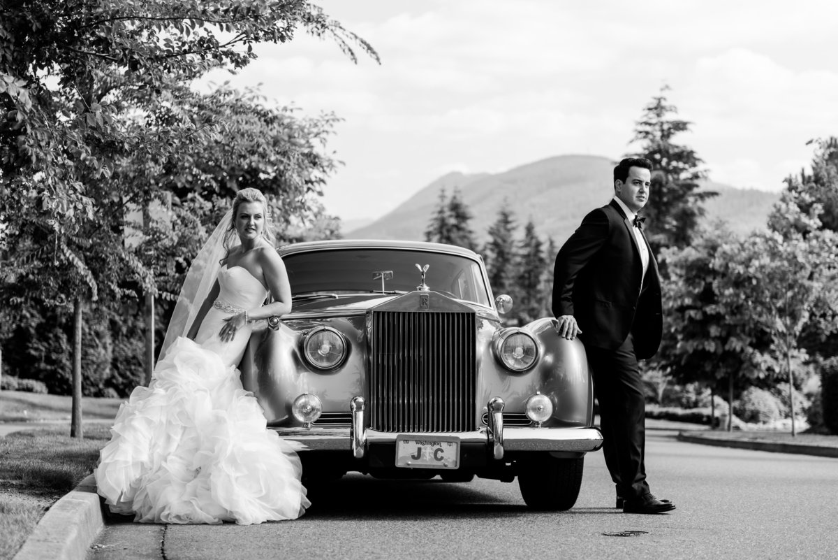 Couple standing by Classic Rolls Royce