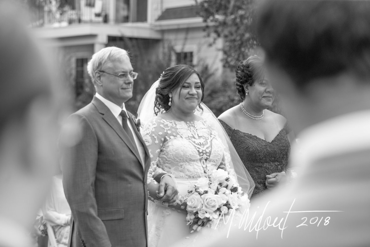 bride stands next to her father