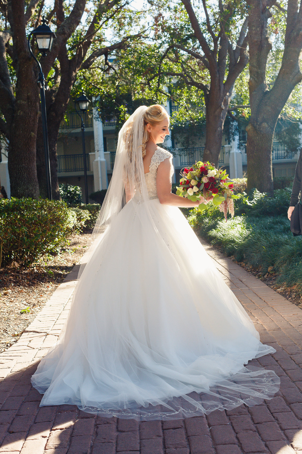 A Bride at a Disney Port Orleans Wedding Looks Back Over Her Shoulder