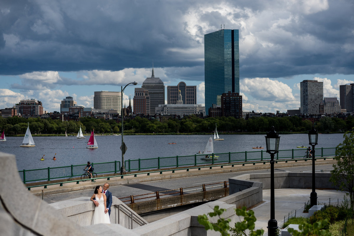 Boston skyline and wedding couple