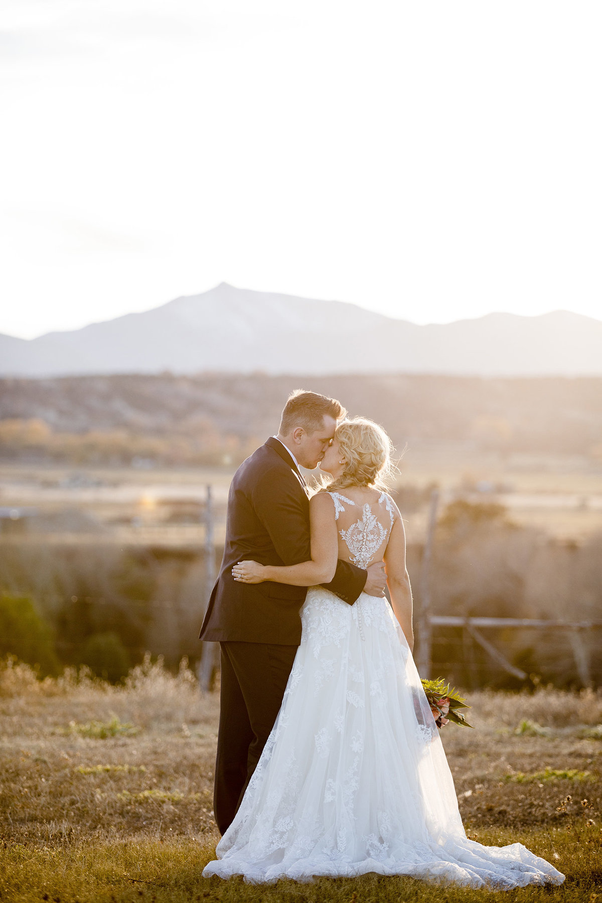 Everett Ranch Rocky Mountain Wedding Outdoor Barn Rustic Salida Colorado Alpaca Collegiate Peaks Vintage Ranch Married Kiss Mount Princeton Yale Harvard 018