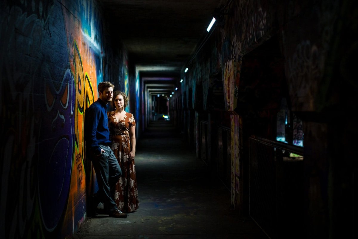 engaged couple poses at Krog Street Tunnel Atlanta