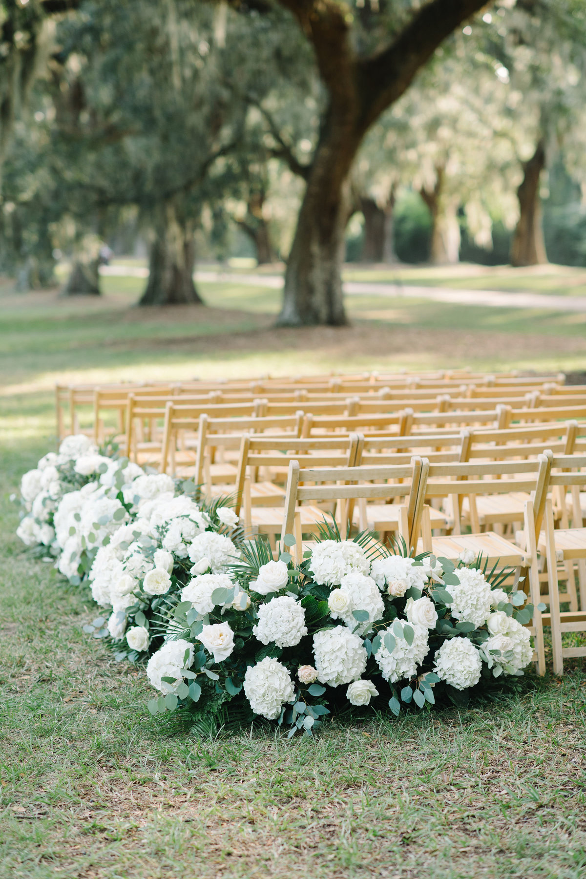 Wedding Ceremony Floral Lined Aisle with White Hydrangeas and Greenery
