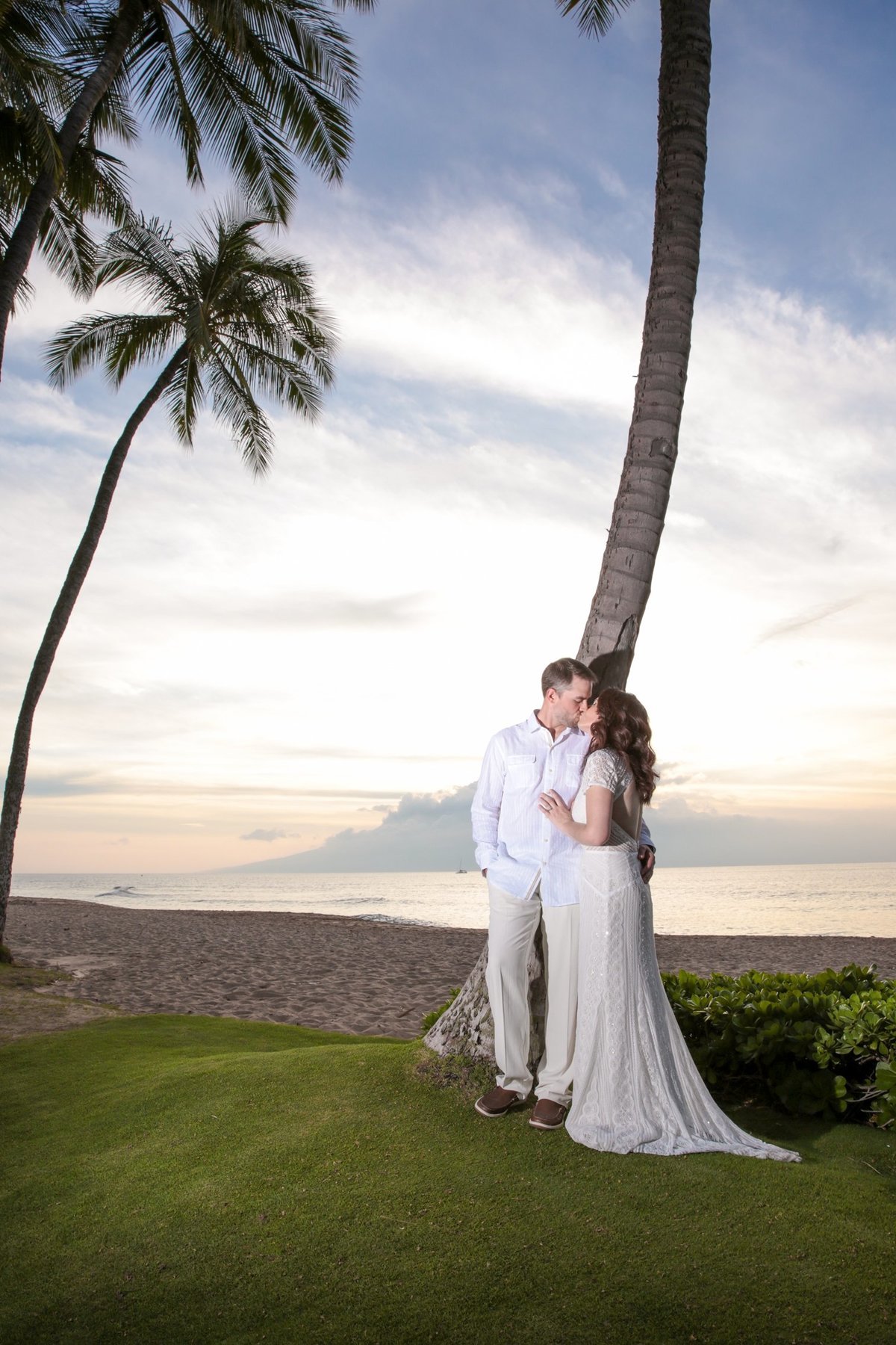 Maui Wedding Photography   at The Westin Maui Resort and Spa  with the bride and groom at sunset