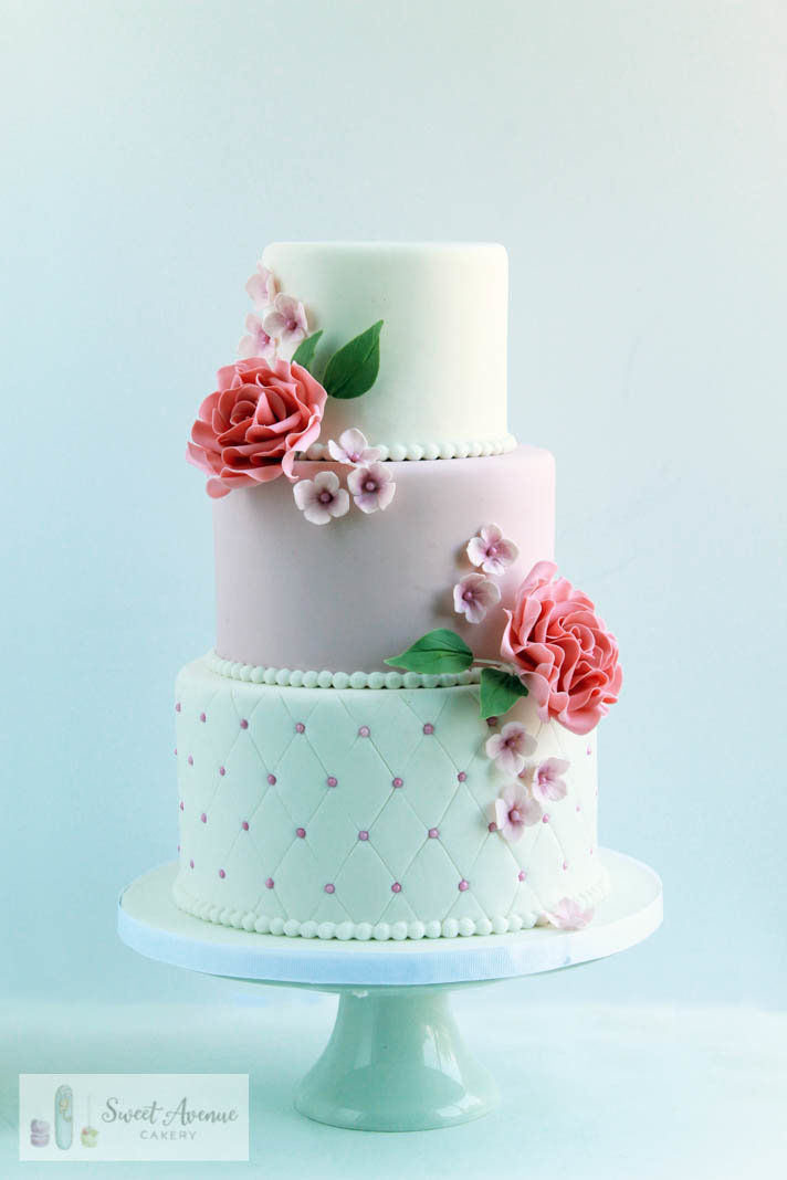 white and blush vintage wedding cake with pink roses and hydrangeas