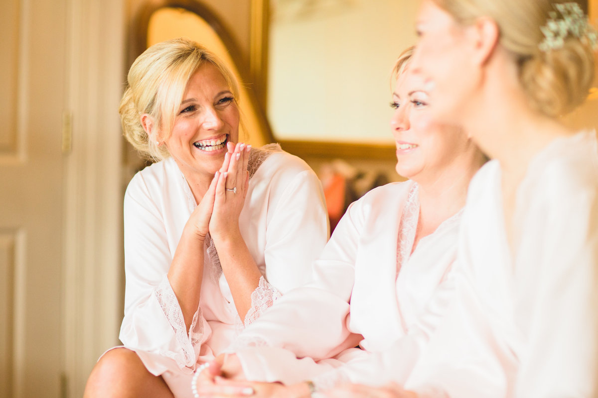reportage photo of bride laughing getting ready