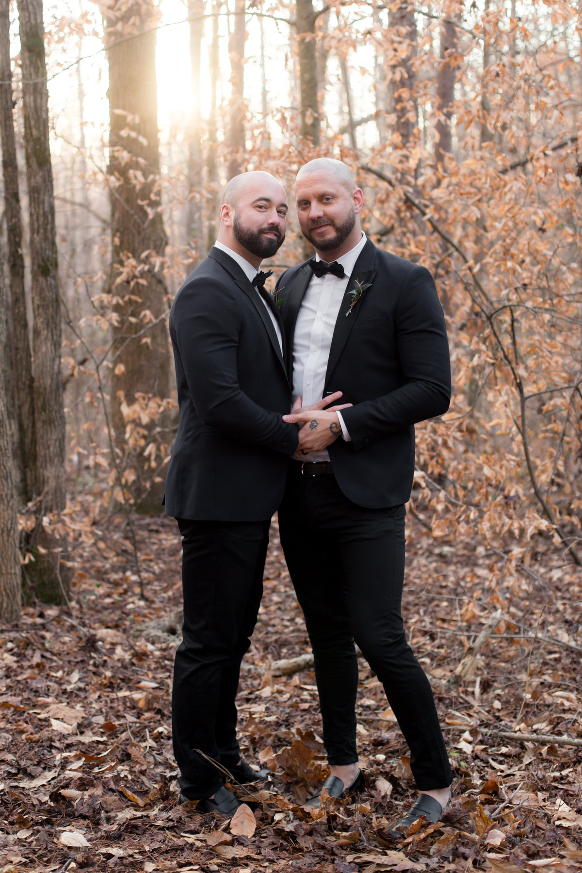 photo of gay married couple in love outdoors in north Carolina