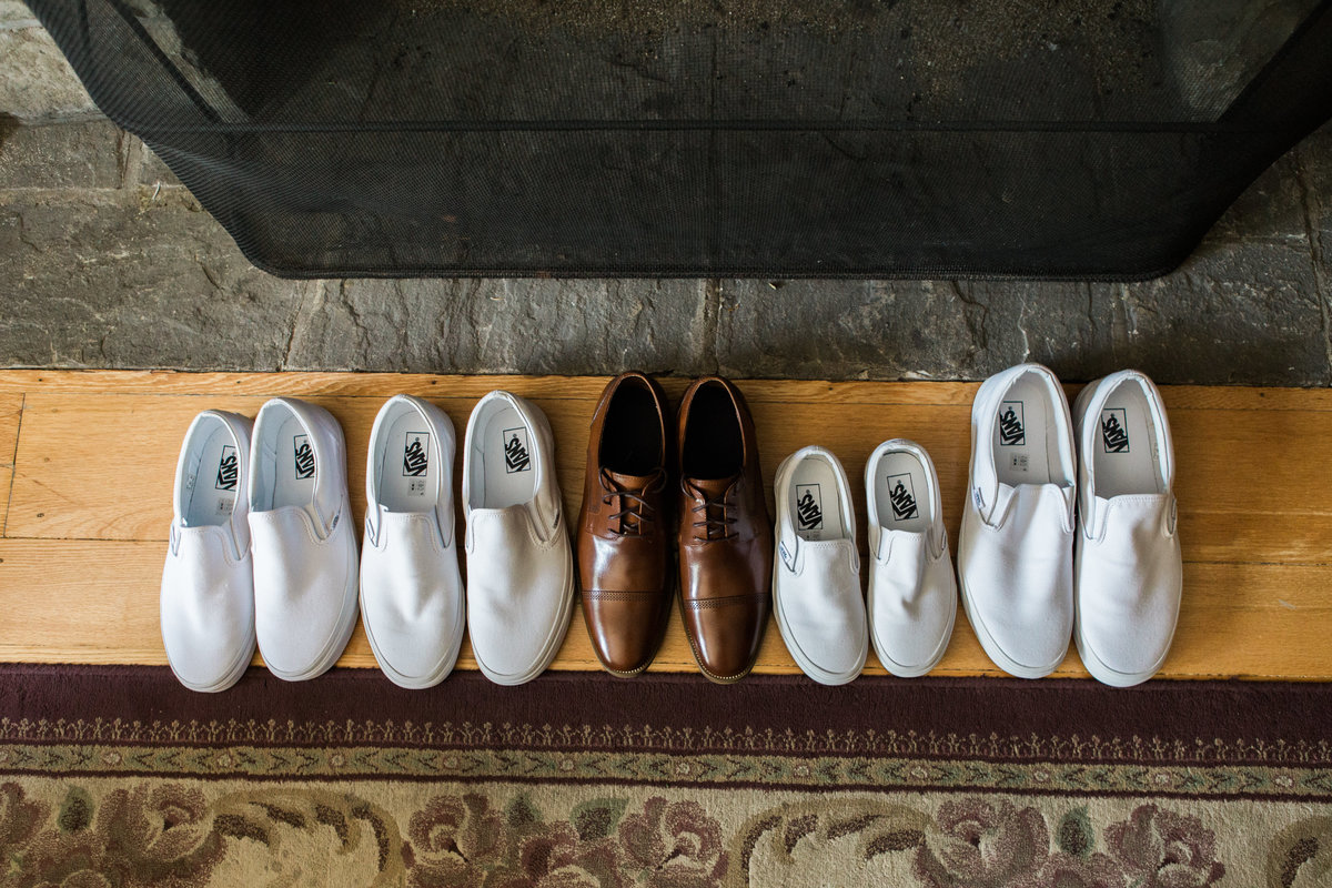 Burlington-Wedding-Photographer-Groomsmen-Shoes-Lined-Up-In-Front-Of-Fireplace