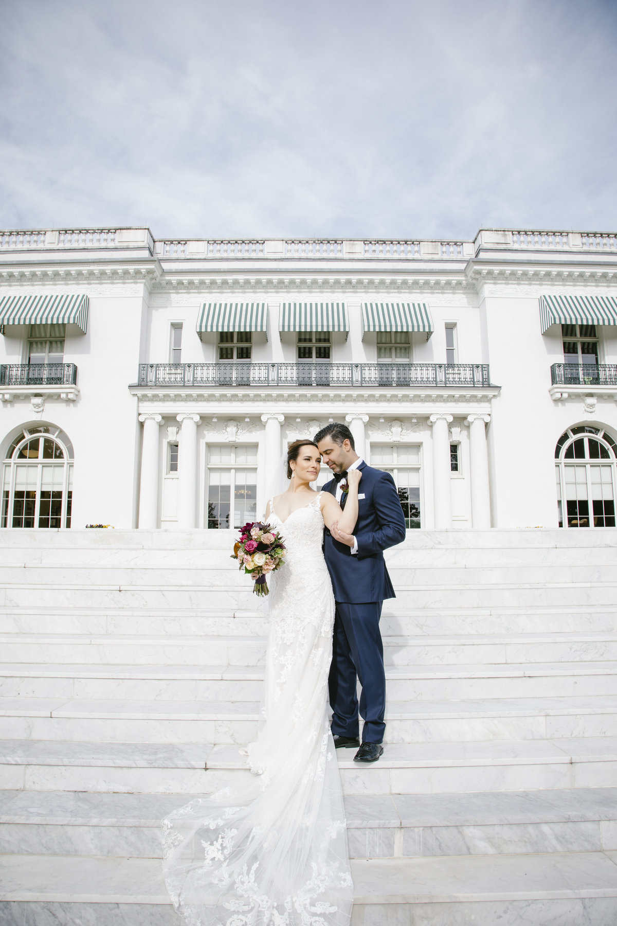 bride and groom outside monmouth university wedding
