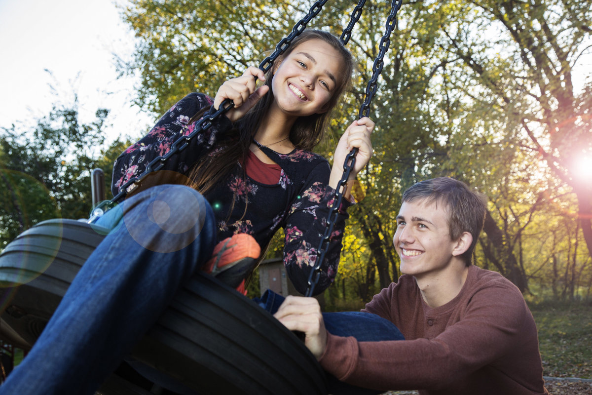 sioux falls family session brother sister play on tire swing sioux rec area south dakota
