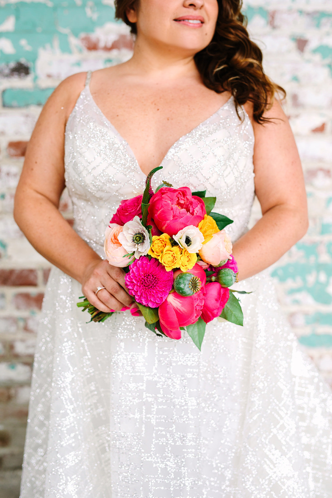 bright bridal bouquet with pink and orange flowers at The Unique Space LA wedding in downtown Los Angeles