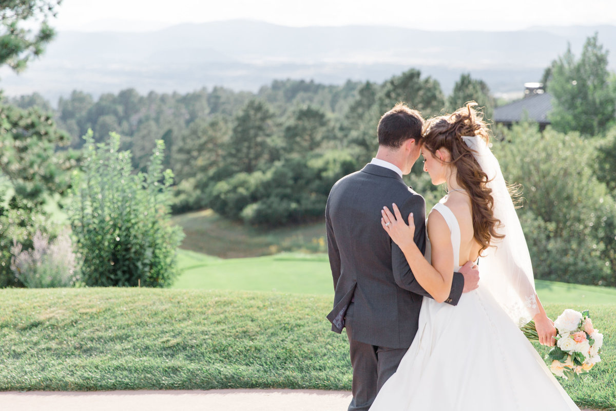 Intimate moment between bride and groom at Castle Pines Golf Club