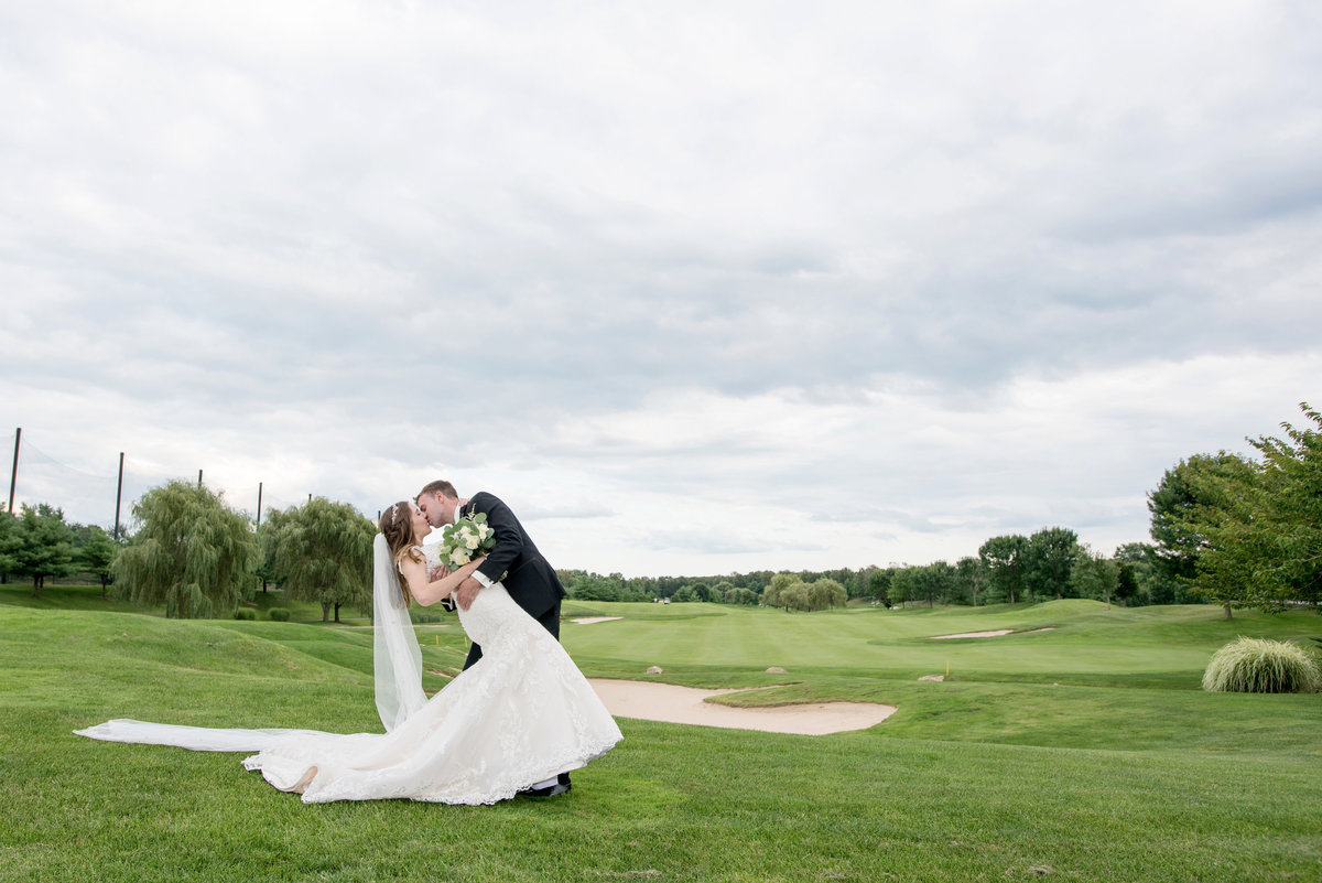 bride and groom on golf course photo Willow Creek Golf and Country Club wedding