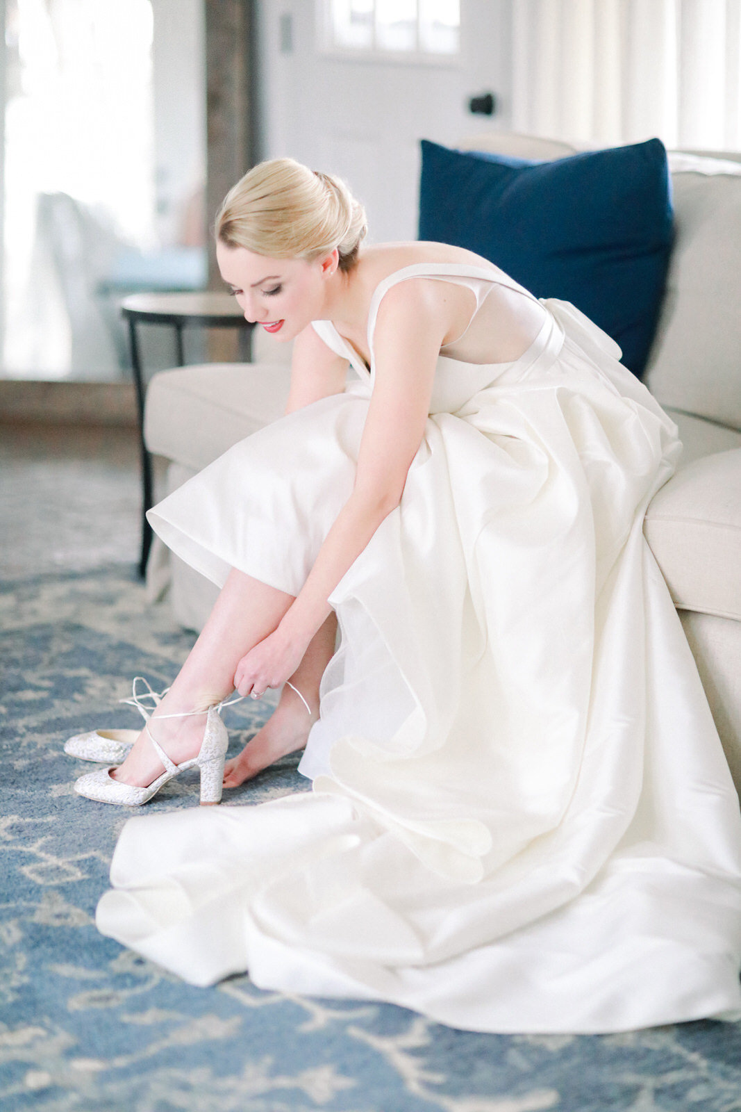 A North Carolina fine art film wedding photographer captures a bride posing getting ready for her Summerfield Farms wedding.