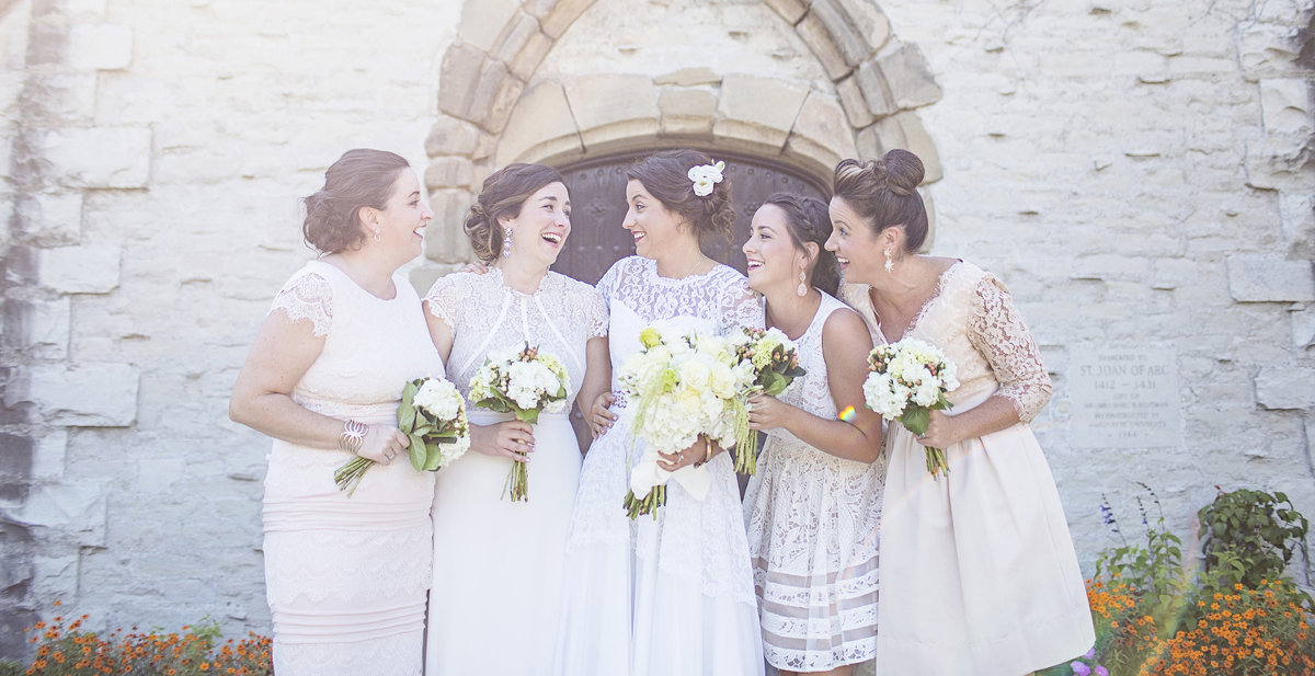Neutral tone bridesmaids and sisters at Marquette University Milwaukee Wisconsin wedding