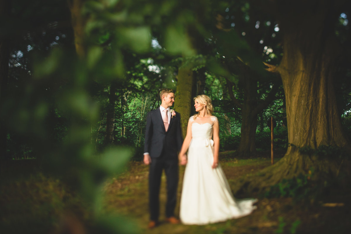 wedding couple walking through a woods