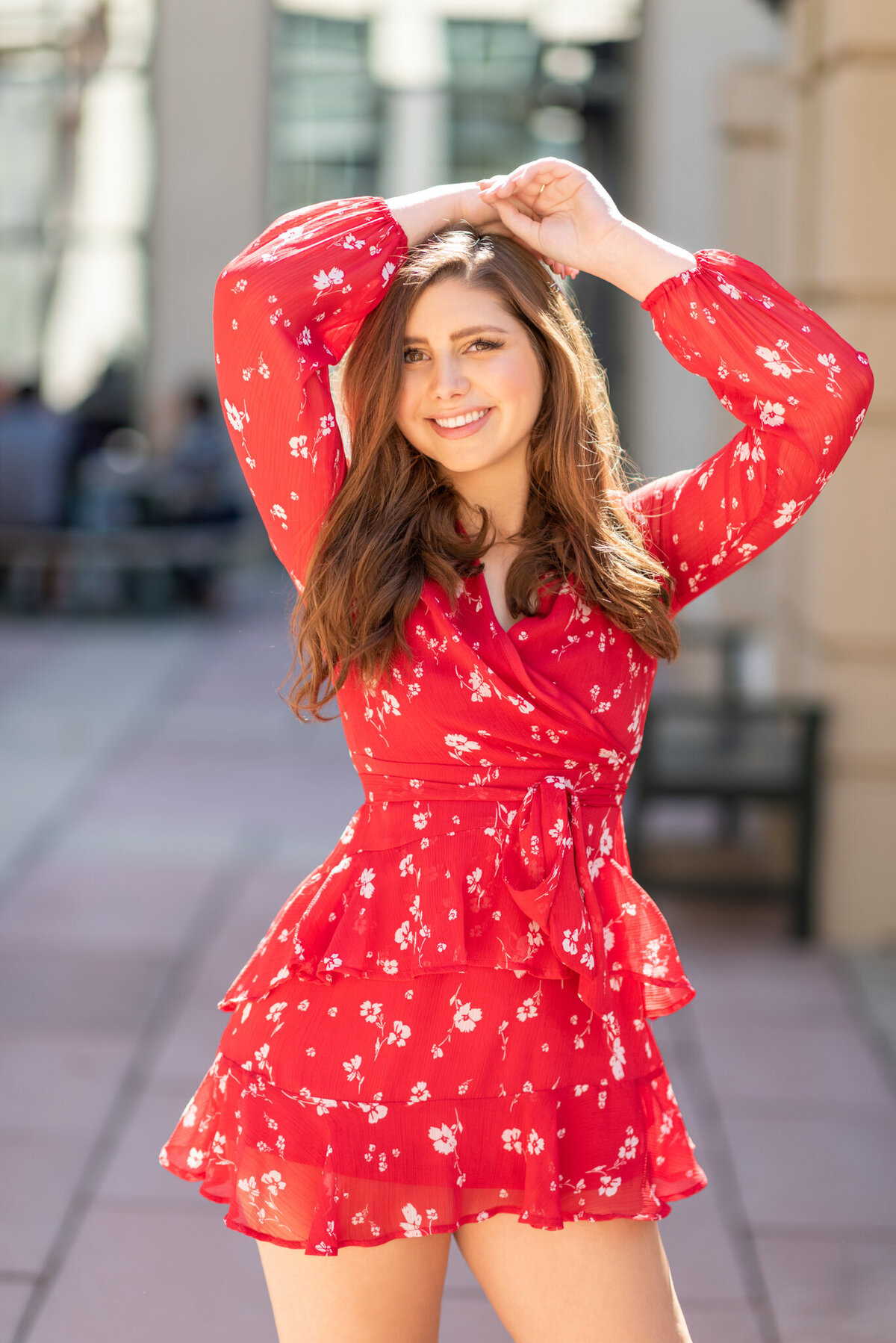 Smiling-woman-in-red-romper-high-school-senior-pictures-ivy-towler-iowa-photography