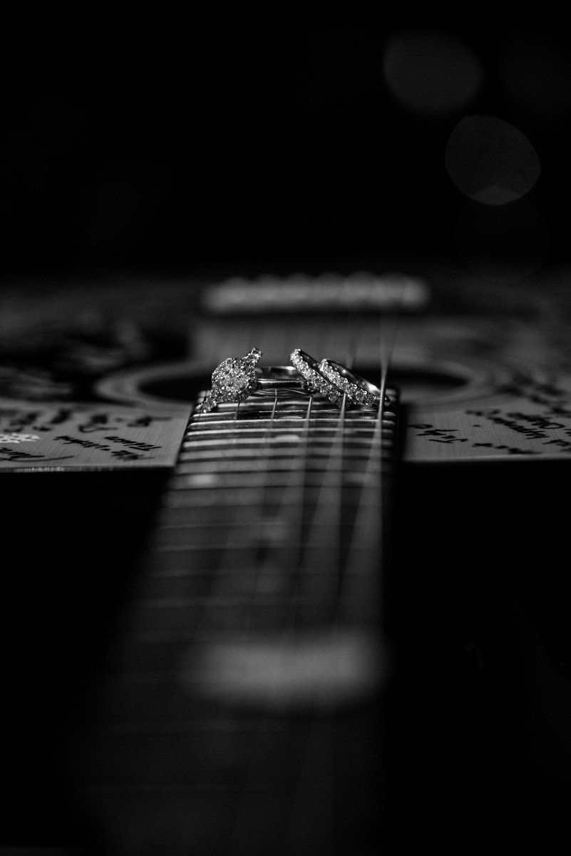 creative photo of wedding rings on a guitar