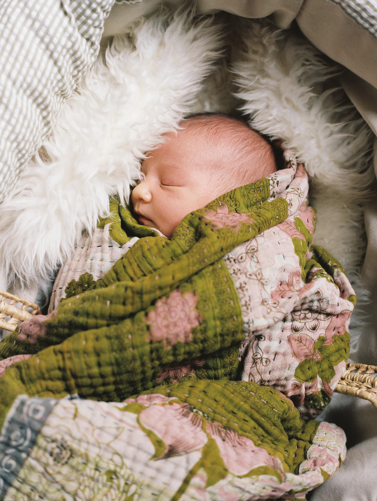 newborn baby wrapped in blankets sleeping