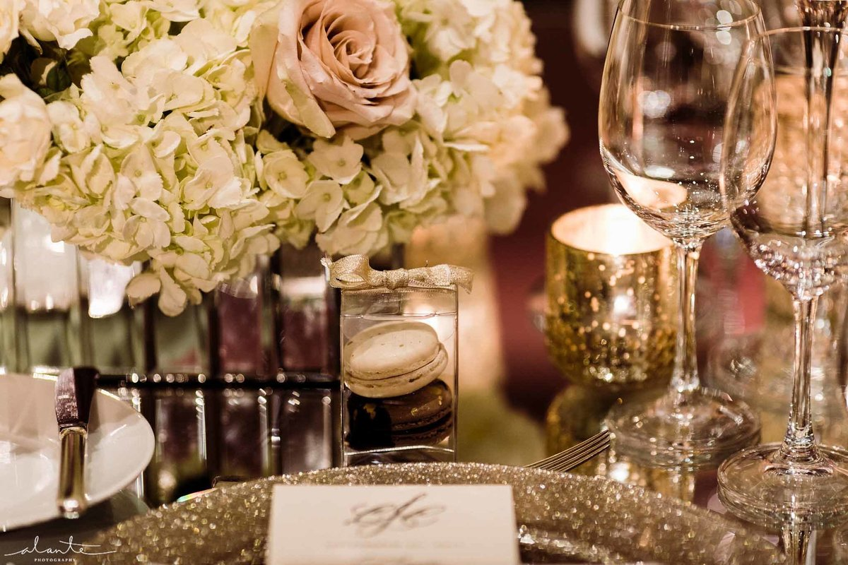 Mirrored vase and tabletop reflect all the candles we used for this romantic winter wedding.