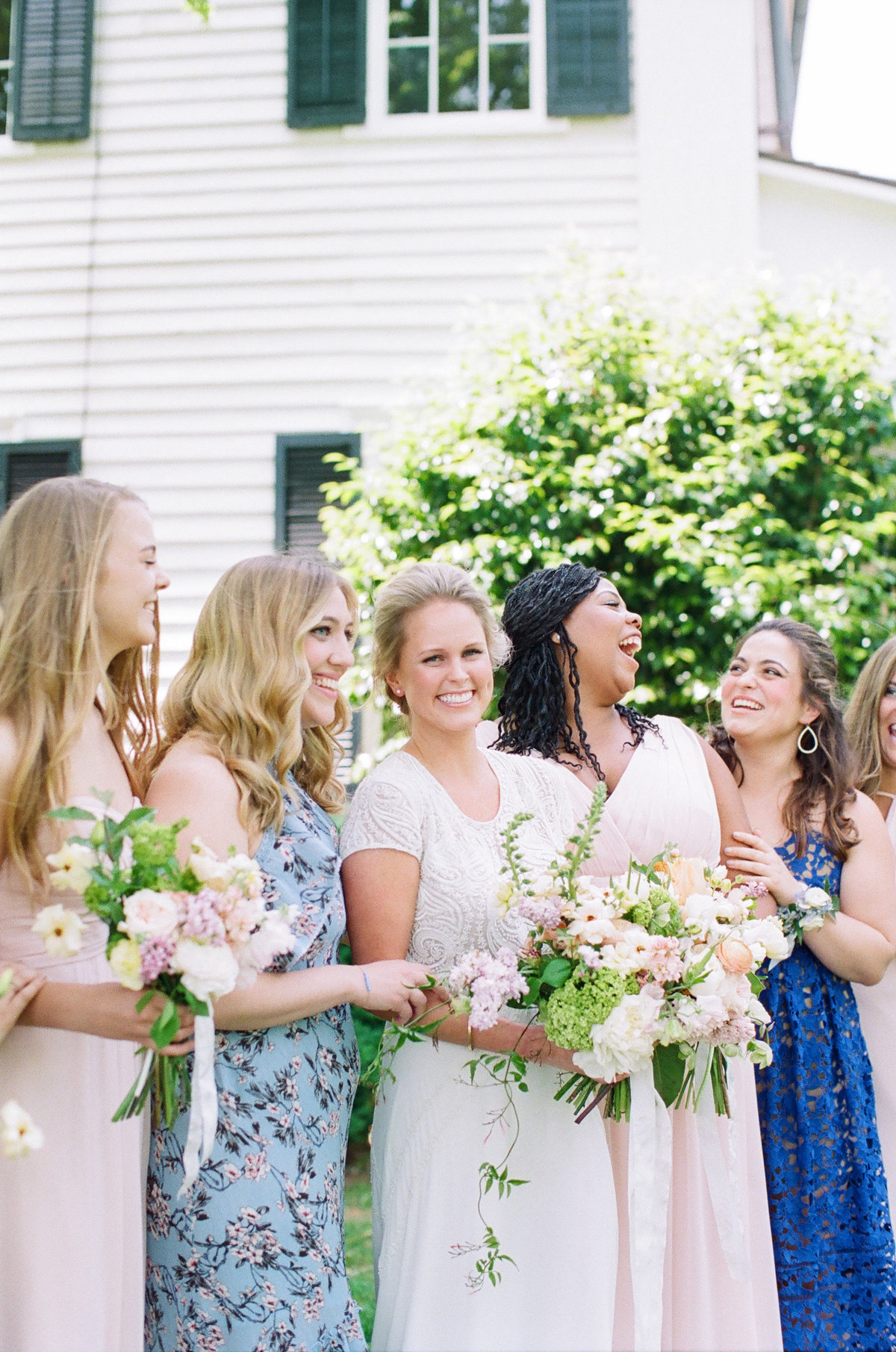 Candid Photo Bride with Bridesmaids