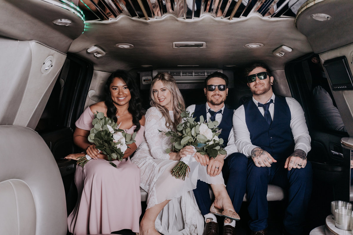 Neon Museum wedding pictures couple arrives at reception in limo