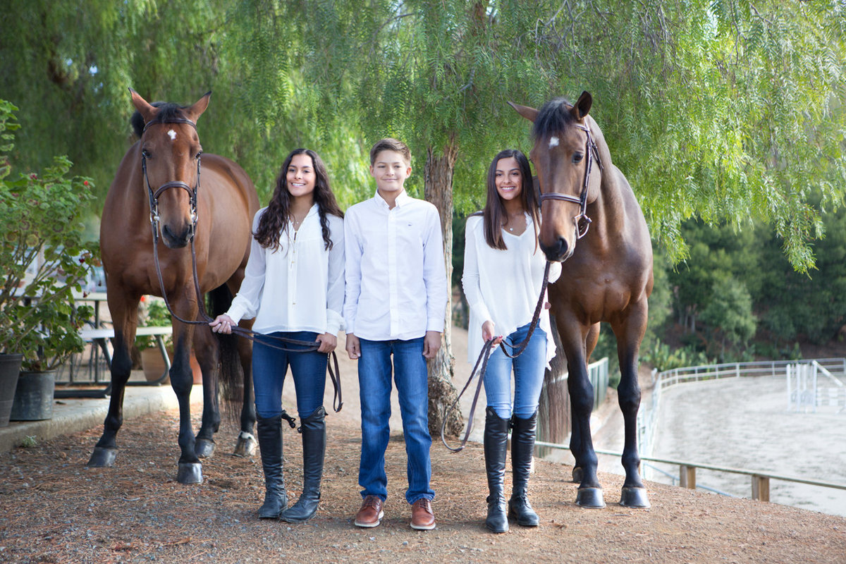 Family of Two Girls One Boy Horses