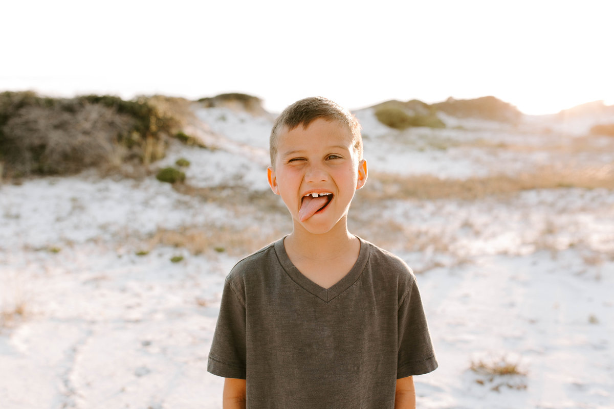 Little boy on beach at family photo session in Seaside Florida