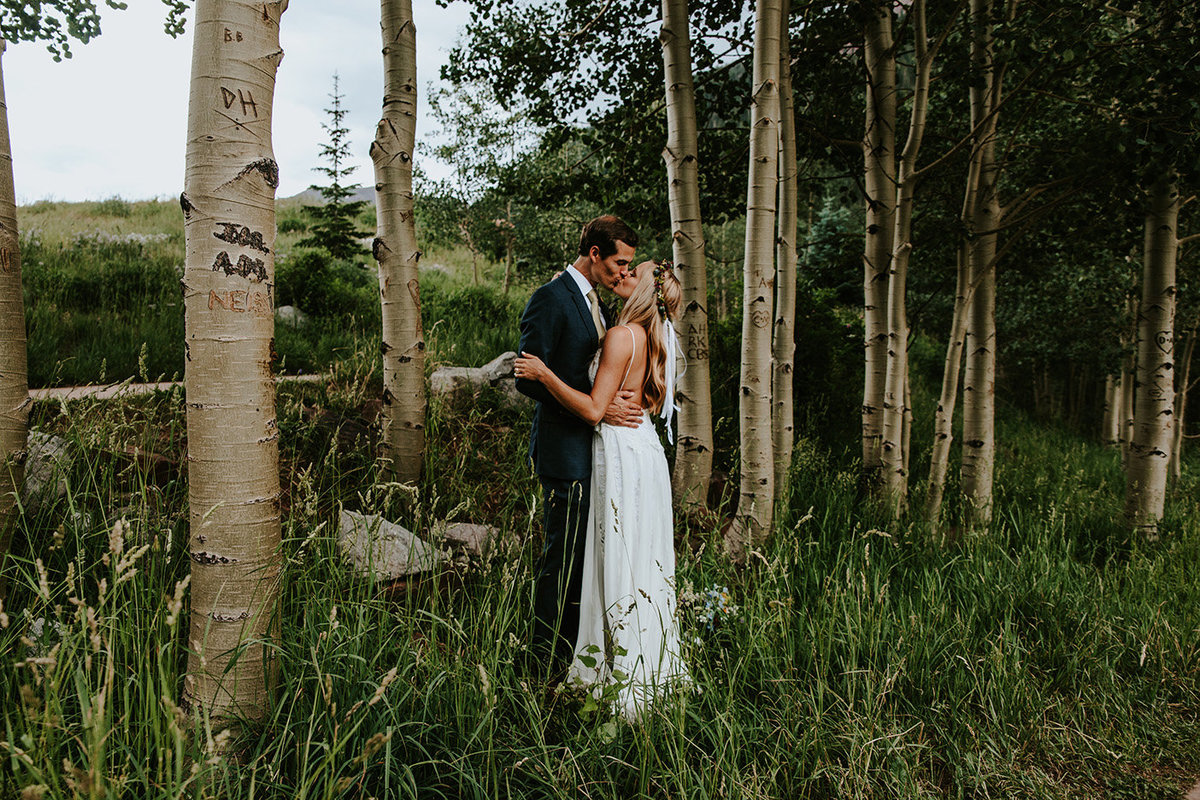 wedding couple kissing in an aspen grove in Aspen Colorado