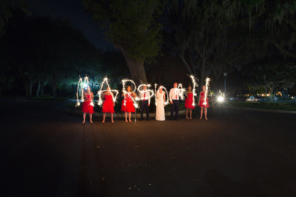 last name in sparklers, fun wedding party photo