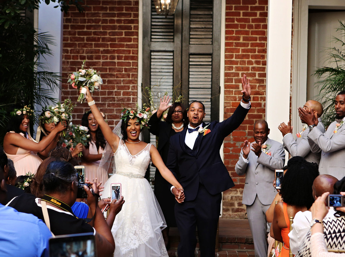 bride and groom celebrate in nola courtyard