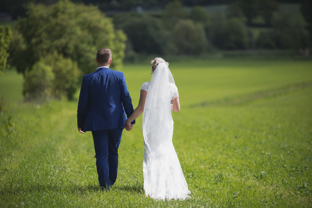 Newly married couple going for a walk at Deer Park in Devon