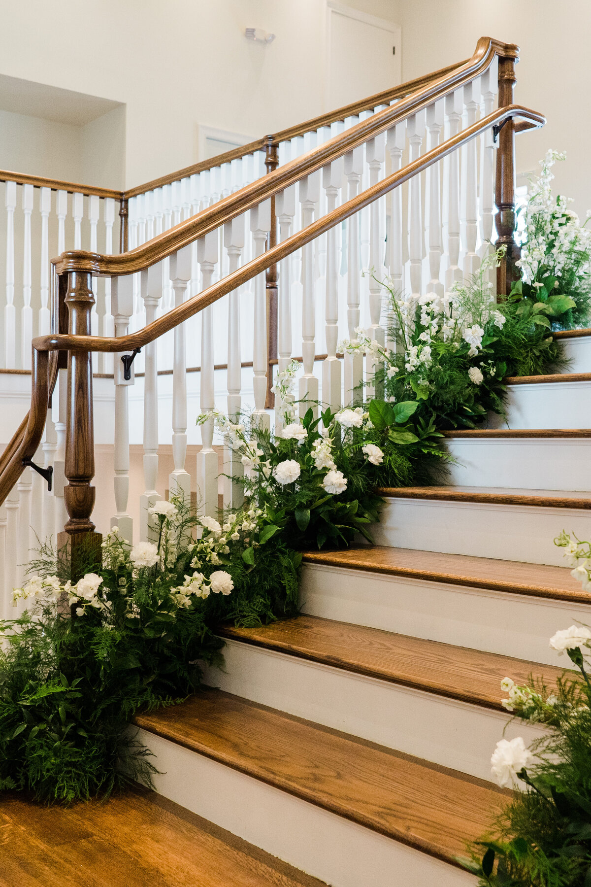 romantic curved staircase surrounded by flowers