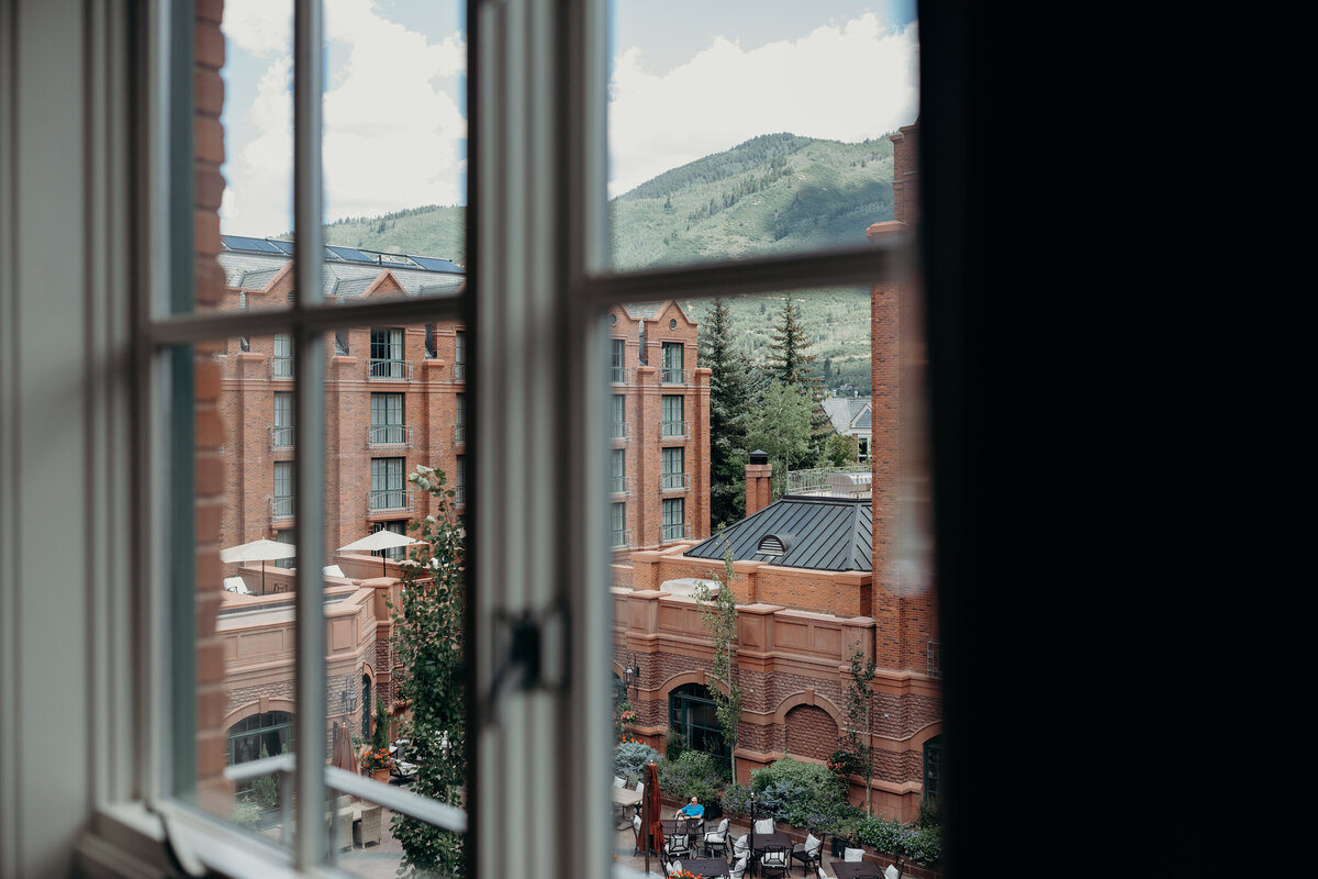gps-aspen-st-regis-looking-out-window