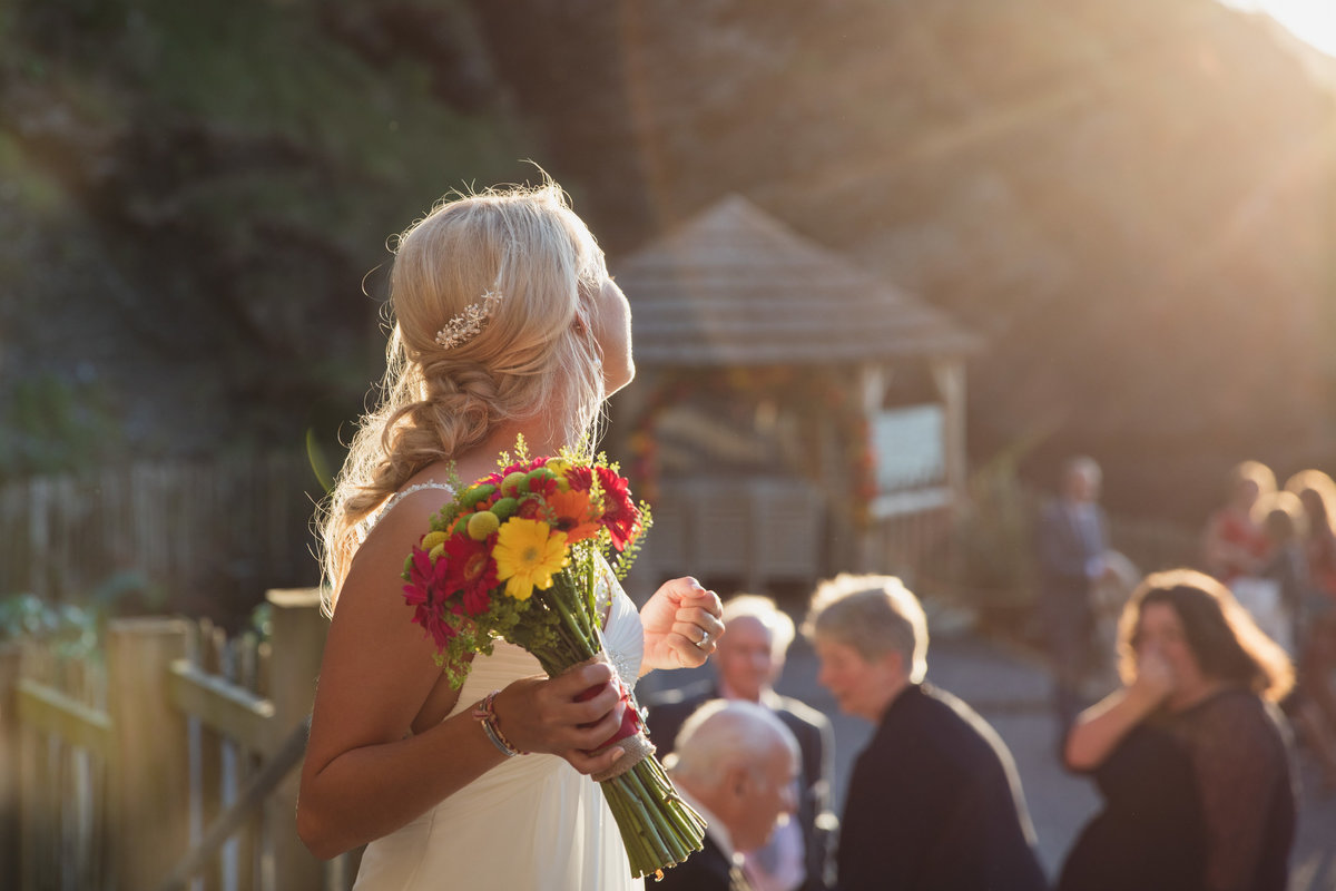 Beautiful natural candid wedding photo at Tunnels Beaches Devon