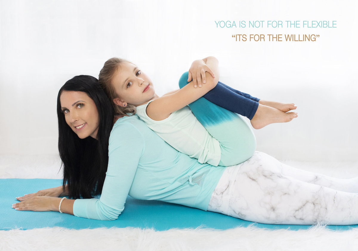 persoanl branding photographs of  yoga  instructor with her daughter  on aqua  color  yoga mat from oakville ontario canada