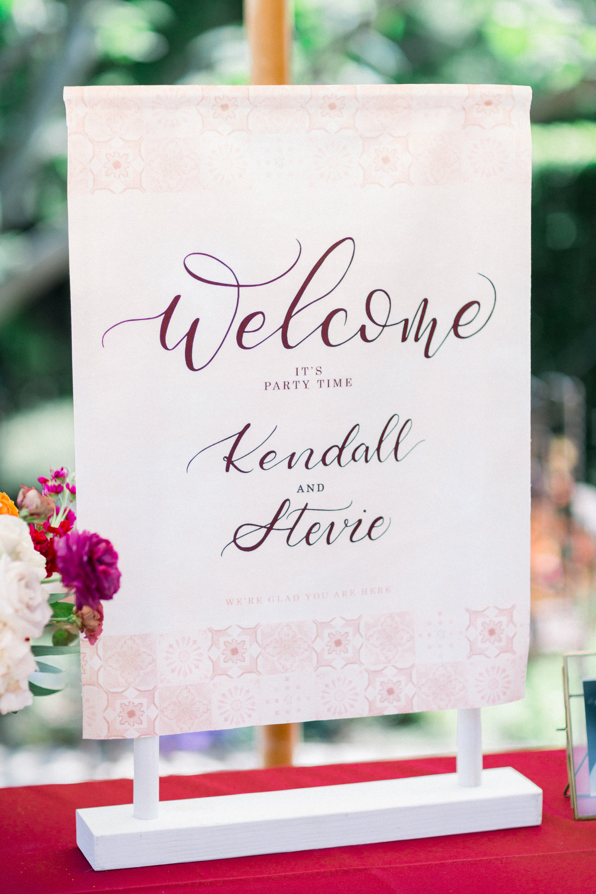 pink velvet wedding welcome sign on welcome table at Maravilla Gardens
