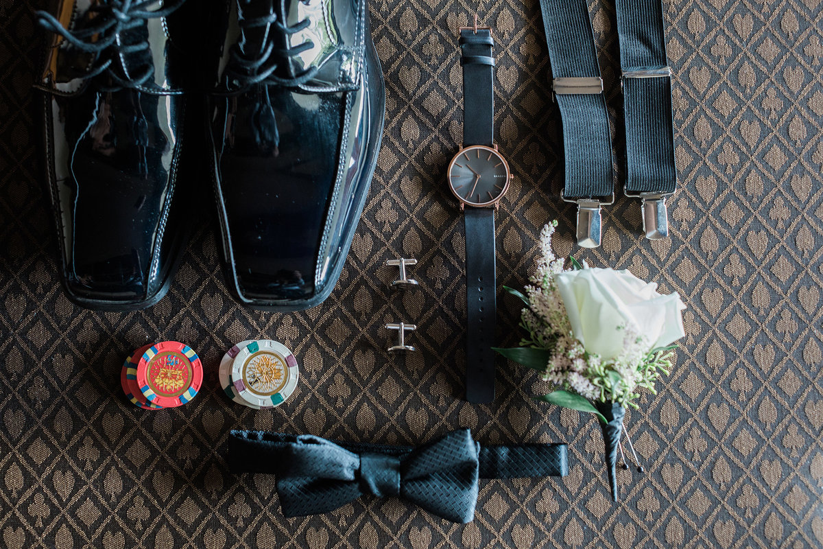 all of the grooms details on a wedding